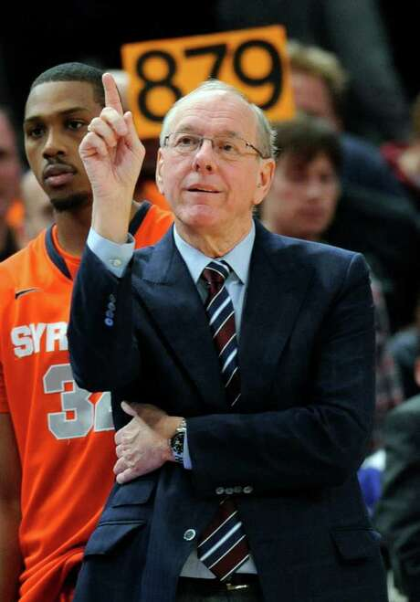 Syracuse coach Jim Boeheim gestures during the second half of an NCAA college basketball game against St. John's Saturday, Feb. 4, 2012, at New York's Madison Square Garden. Boeheim earned his 879th career coaching win, as Syracuse defeated St. John's 95-70. (AP Photo/Bill Kostroun) Photo: Bill Kostroun / FR51951 AP