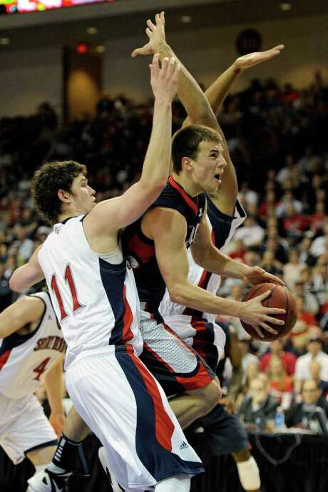 Gonzaga's Kevin Pangos, right, encounters resistance from Clint Steindl during a 3-for-18 shooting night. Photo: Ethan Miller / 2012 Getty Images