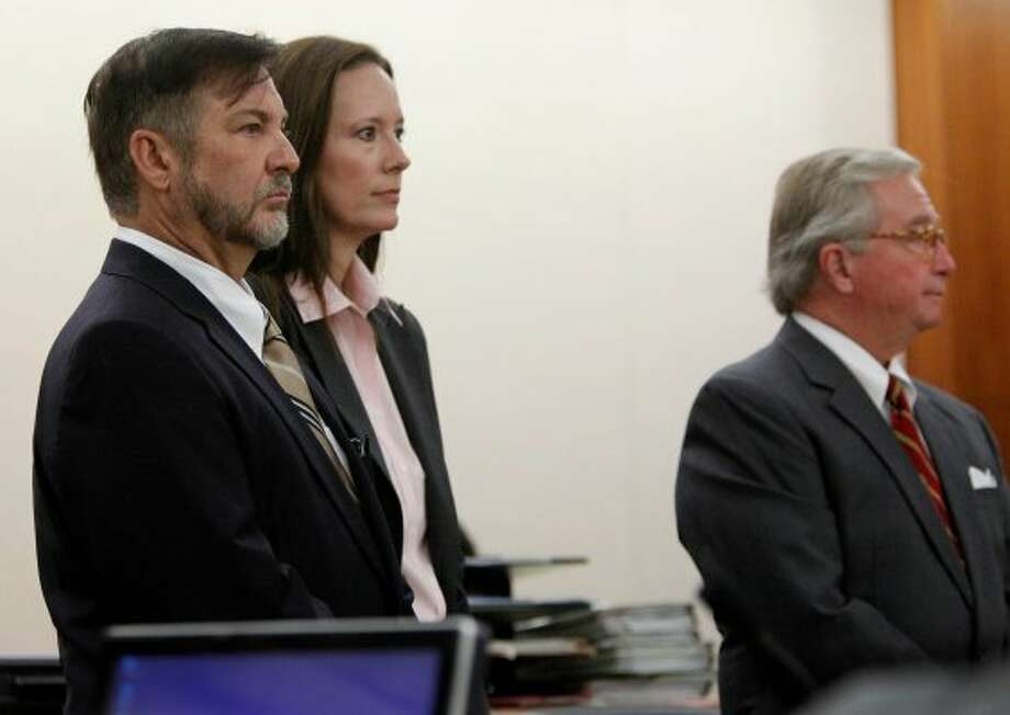 Brown stands with his legal team during the start of his trial Tuesday. (Mayra Beltran / Houston Chronicle)