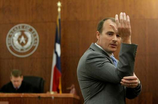 Prosecutor Nathan Hennigan explains to the jury how Brown allegedly assaulted his wife. (Mayra Beltran / Houston Chronicle)