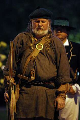San Antonio Living History Association member Randy Pike lowers his head during the presentation of the 176th anniversary remembrance of the Battle of the Alamo at Alamo Plaza, Tuesday, March 6, 2012. Photo: Jerry Lara, San Antonio Express-News / © 2012 San Antonio Express-News