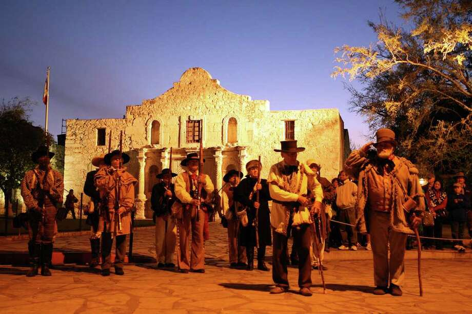 Members of the San Antonio Living History Association stand at attention during the presentation of the 176th anniversary remembrance of the Battle of the Alamo at Alamo Plaza, Tuesday, March 6, 2012. Photo: Jerry Lara, San Antonio Express-News / © 2012 San Antonio Express-News