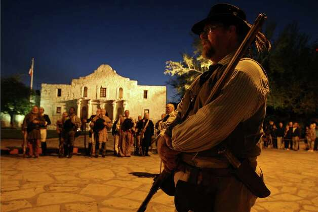 Portraying an Alamo defender, Pad Kelly stands at attention during the San Antonio Living History Association's 176th anniversary remembrance of the Battle of the Alamo at Alamo Plaza, Tuesday, March 6, 2012. Photo: Jerry Lara, San Antonio Express-News / © 2012 San Antonio Express-News