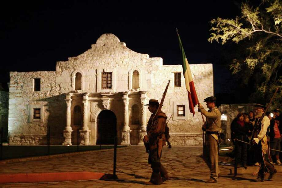 Members of the San Antonio Living History Association present the 1824 Mexican flag during the 176th anniversary remembrance of the Battle of the Alamo at Alamo Plaza, Tuesday, March 6, 2012. Photo: Jerry Lara, San Antonio Express-News / © 2012 San Antonio Express-News