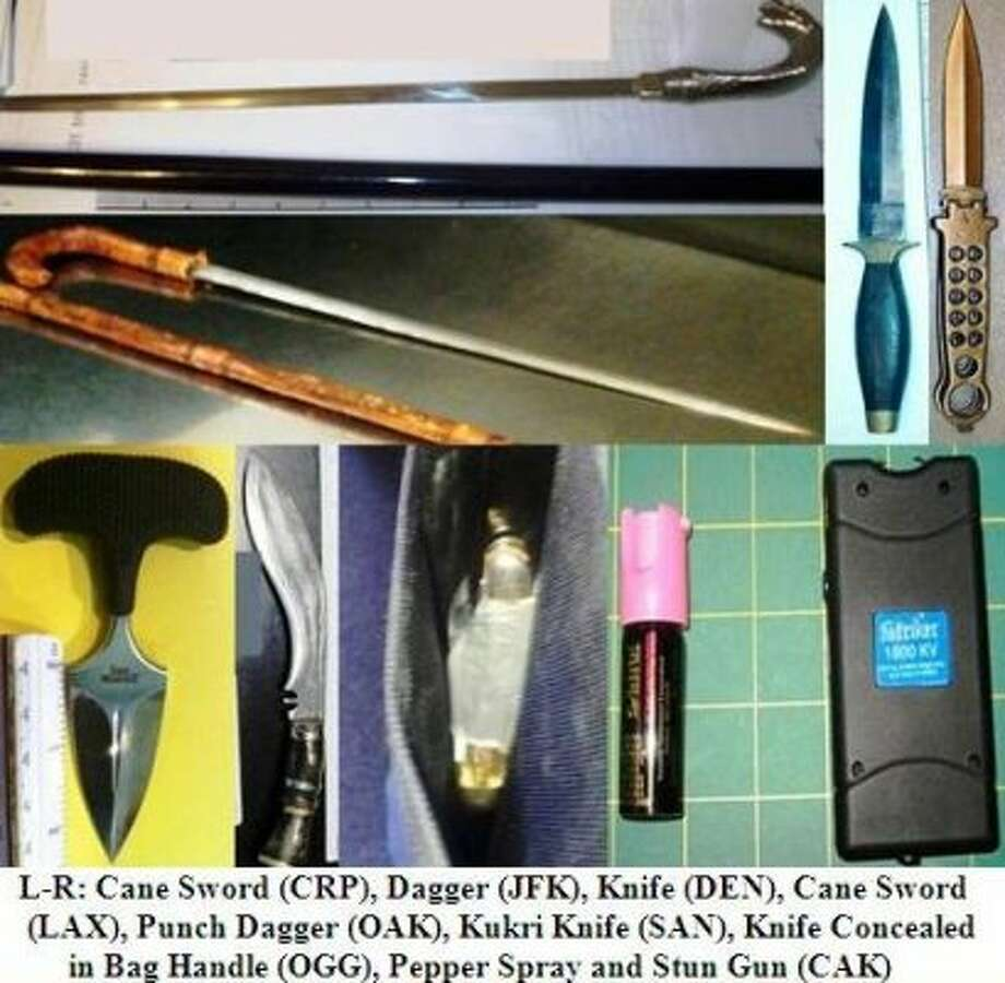 This image provided by the Transportation Security Administration shows a collection of items confiscated by the agency in 2012.