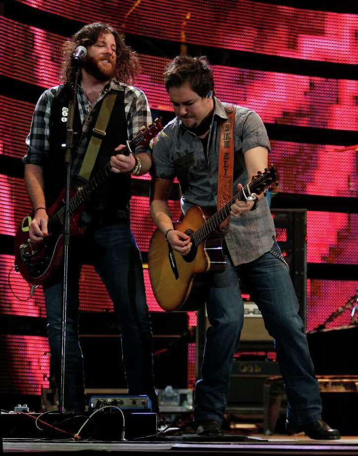 James Young left, and Mike Eli with The Eli Young Band performs in concert during the Houston Livestock Show and Rodeo at Reliant Stadium Monday, March 5, 2012, in Houston. Photo: James Nielsen, Chronicle / © 2011 Houston Chronicle
