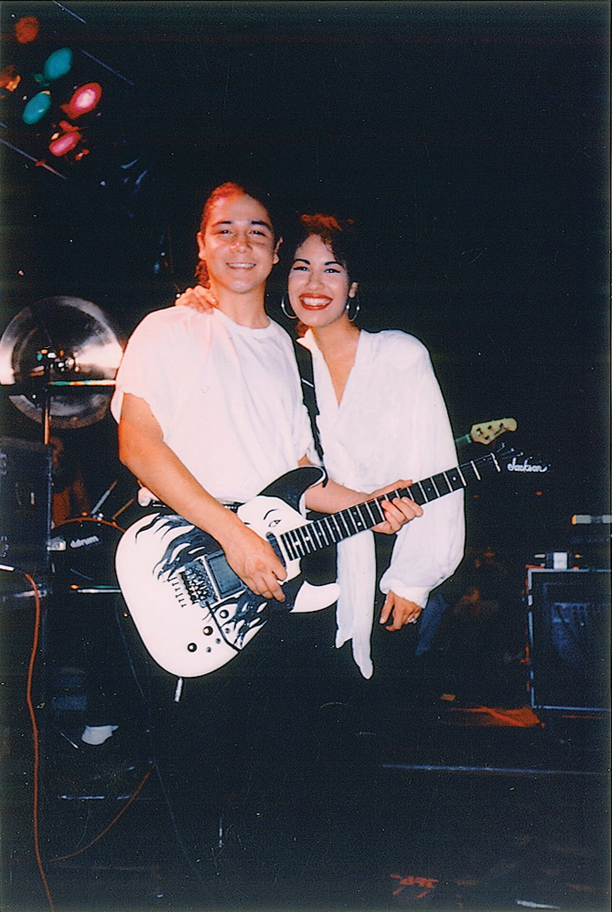 Selena onstage with her husband, guitarist Chris Perez, who has written a book about their life together.