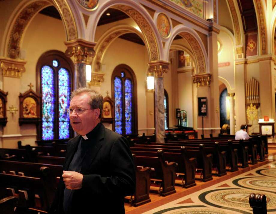 """Father Gary Thomas, a leading authority on exorcism, is visting the Beaumont Catholic Diocese to give a talk about demonic possession and the ancient rites by which they are expelled. He had a chance to talk with the media Monday afternoon. Thomas, one of few Vatican-certified exorcists ministering in the United States, is the inspiration for the 2011 thriller, """"THE RITE"""" starring Anthony Hopkins. He was the theological consultant for the film that is based on the book """"THE RITE,"""" The Making of a Modern Exorcist by Matt Baglio.   Dave Ryan/The Enterprise Photo: Dave Ryan"""