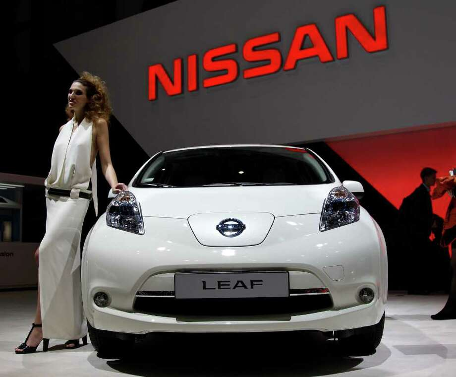 The Nissan ILeaf is on display on Tuesday, March 6, 2012 during the press preview days at the 82nd Geneva International Motor Show in Geneva, Switzerland. The Motor Show will open it's doors to the public from March 8 to 18, presenting more than 260 exhibitors and more than 180 world and European premieres. (AP Photo/Frank Augstein) Photo: Frank Augstein, Associated Press / AP