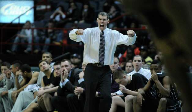 Troy coach Richard Hurley leads his team during their 62-57 overtime loss to CBA in the Section II Class AA boys basketball final at the Times Union Center on Monday night March 5, 2012 in Albany, N.Y. CBA won their fourth straight Section II crown, and were in the finals for the 10th straight time.  (Philip Kamrass / Times Union ) Photo: Philip Kamrass / 00016679A