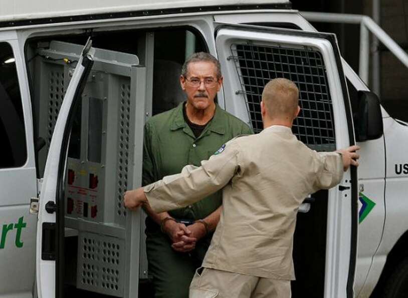 Indicted financier R. Allen Stanford, accused of leading a $7 billion investment fraud scheme, left,