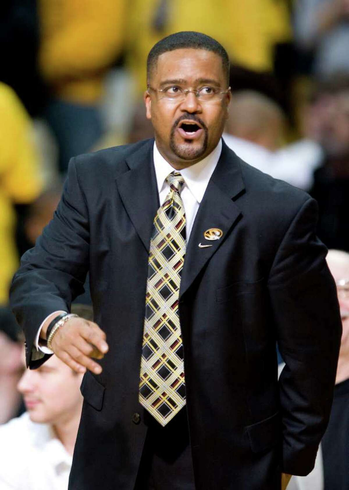 Missouri head coach Frank Haith discusses a call with a referee during the second half of an NCAA college basketball game against Baylor Saturday, Feb. 11, 2012, in Columbia, Mo. Missouri won the game 72-57.