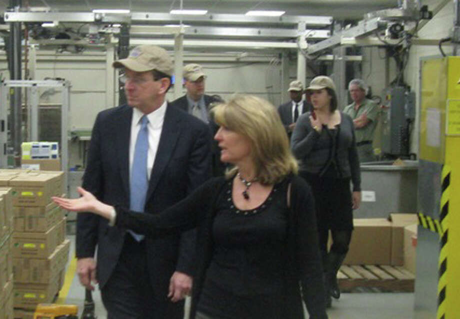Gov. Dannel P. Malloy is given a tour of the Bigelow Tea headquarters in Fairfield on Monday by Cindi Bigelow, the company president. Photo: Contributed Photo / Fairfield Citizen contributed
