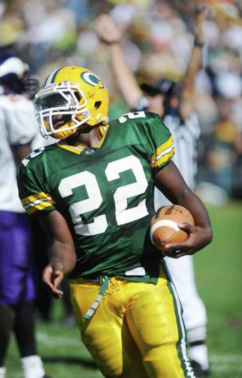 Trinity Catholic High School's Shaquan Howsie scores a touchdown against Westhill High School in city rivalry football action at Trinity in Stamford, Conn. on Saturday October 2, 2010.