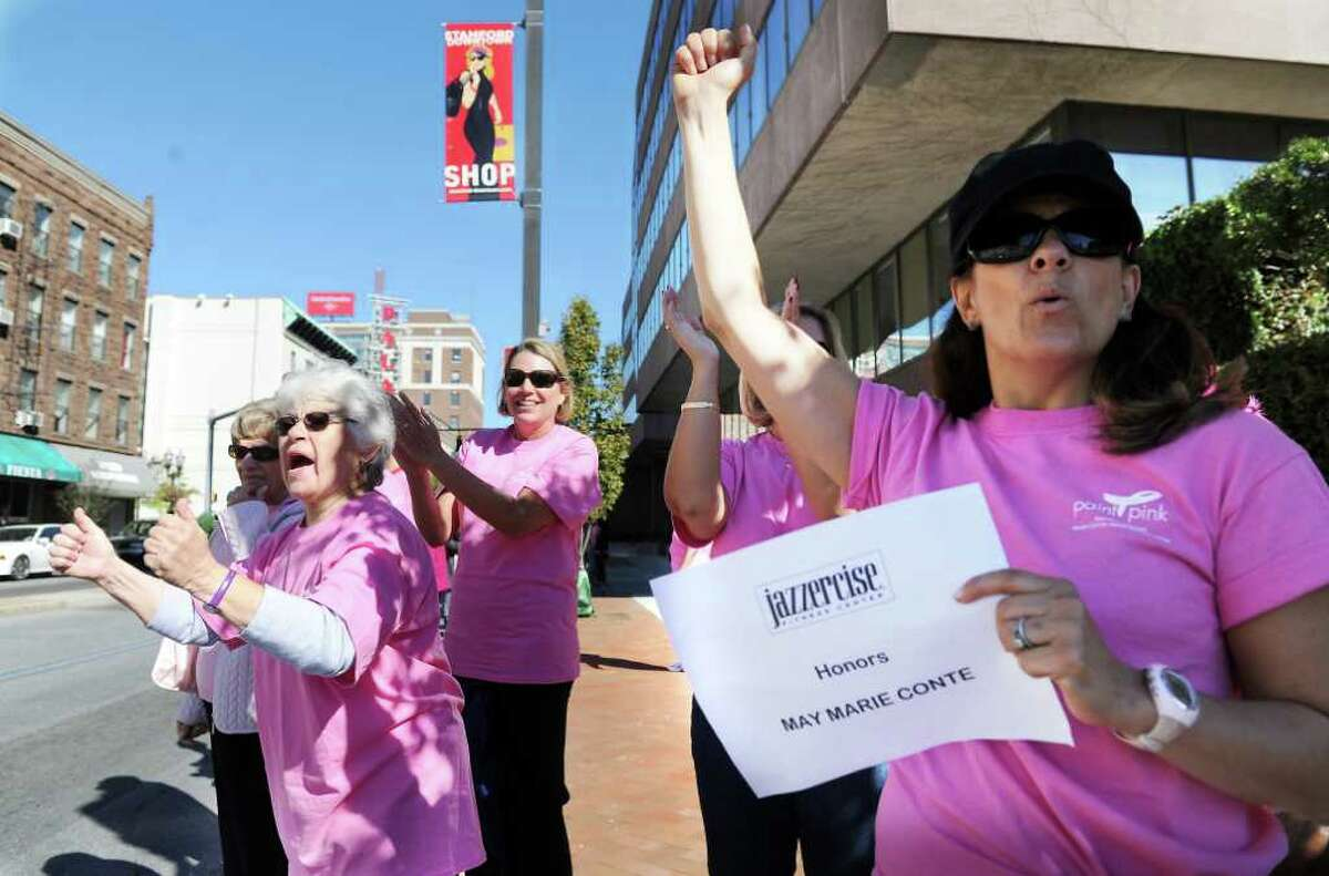 Karen Sabia and Kristen Rzasa join other supporters and breast cancer survivors as they gather along Atlantic Street to create a