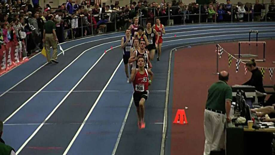 NEW ENGLAND'S BEST Fairfield Warde High School's Harry Warnick leads the field Saturday on his way to winning the New England high school indoor championship in the 1,600-meter run  in Boston. Warnick is the first Fairfield runner to win a New England title at least since the town split into two public high schools in 2004. Photo: Contributed Photo