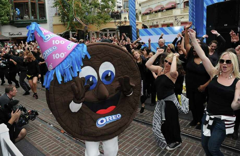 A flash mob dances with an actor dressed in an Oreo Cookie costume at a birthday party to celebrate the 100th anniversary of the Oreo cookie, March 6, 2012 in Los Angeles.  The event marks the centennial of the popular cookie which was created 100 years ago at a Nabisco factory in New York City. Photo: ROBYN BECK, AFP/Getty Images / AFP
