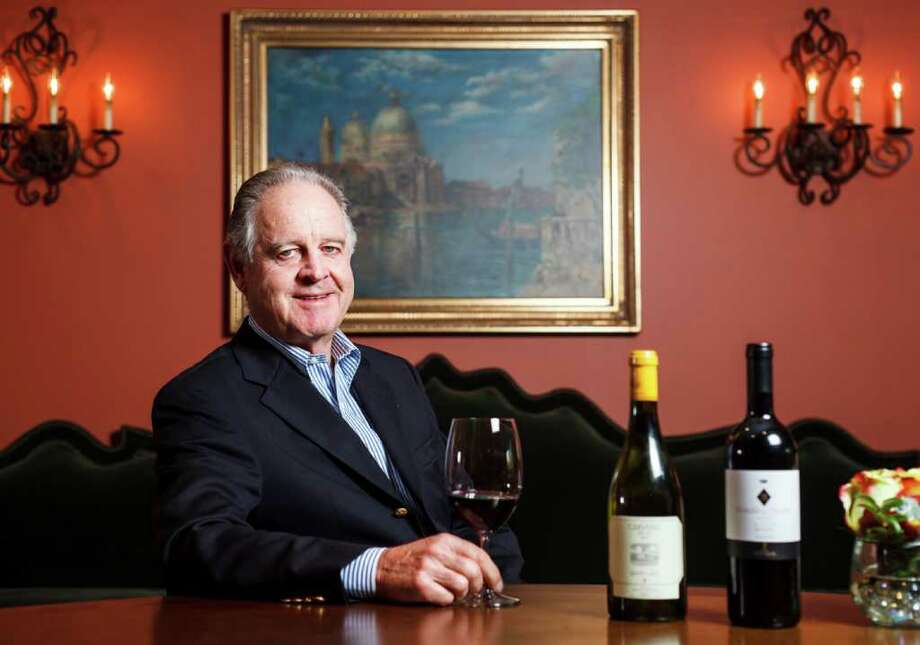 Marchese Piero Antinori, the patriarch of one of the oldest wine families, 26 generations dating from the 14th century, poses for a portrait with a bottle of his 2007 Guada al Tasso Bolgheri Superiore from Tuscany, that won the Houston Rodeo's 2012 Grand Champion wine, while at the Hotel Granduca, Saturday, March 3, 2012, in Houston. ( Michael Paulsen / Houston Chronicle ) Photo: Michael Paulsen / © 2012 Houston Chronicle