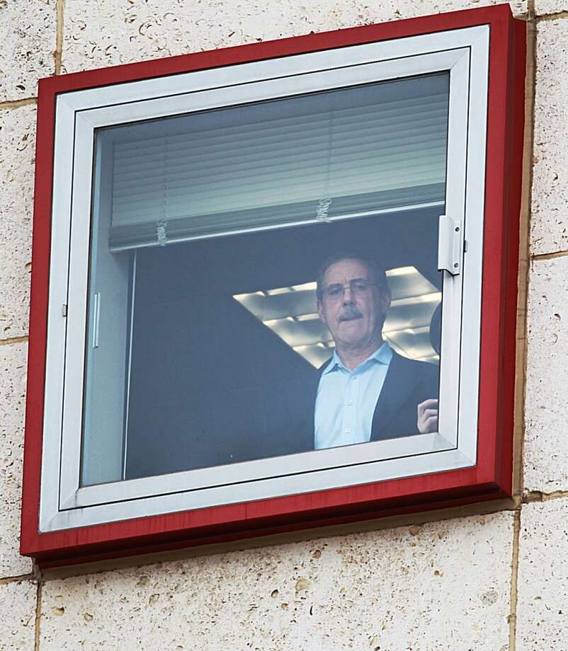 R. Allen Stanford looks out the window of the Bob Casey courthouse on Tuesday afternoon. Photo: Nick De La Torre, Houston Chronicle