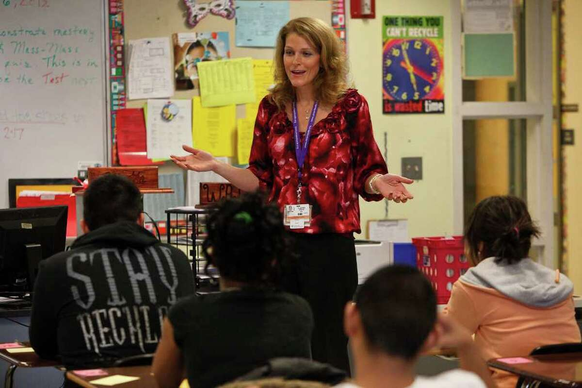SA LIFE - Dr. Kristen Plastino-Arnold, the UT Teen Health Project Director, speaks to students about the program at East Central High School on Thursday, Feb. 16, 2012. LISA KRANTZ/San Antonio Express-News