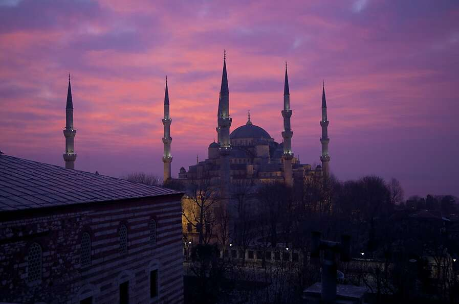 The sun rises behind the Blue Mosque in the Sultanahmet area of Istanbul on February 22, 2012 in Ist
