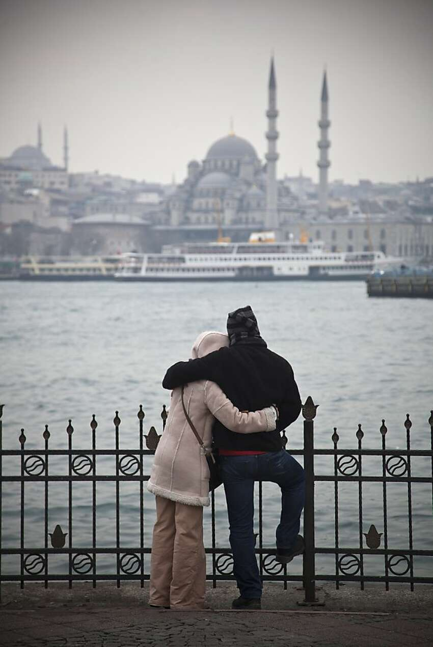 ISTANBUL, TURKEY - FEBRUARY 24: A couple look over the Bosphorus on February 24, 2012 in Istanbul, Turkey. Though not the capital, Istanbul is the cultural, economic, and financial heart of Turkey with a population of over 13 million people. Situated on the Bosphorus strait, this metropolis, a former capital of the Roman Empire, spans Europe and Asia, the only city in the world to cross two continents. The city is dominated by historical monuments from the Byzantine and Ottoman era, with modern nightclubs, up-market restaurants and boutique hotels helping the city become a tourist hotspot. Istanbul was awarded the status of European Capital of Culture in 2010. (Photo by Dan Kitwood/Getty Images)