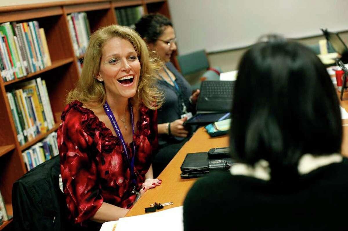 SA LIFE - Dr. Kristen Plastino-Arnold, the UT Teen Health Project Director, meets with health educators with the program at East Central High School on Thursday, Feb. 16, 2012. LISA KRANTZ/San Antonio Express-News