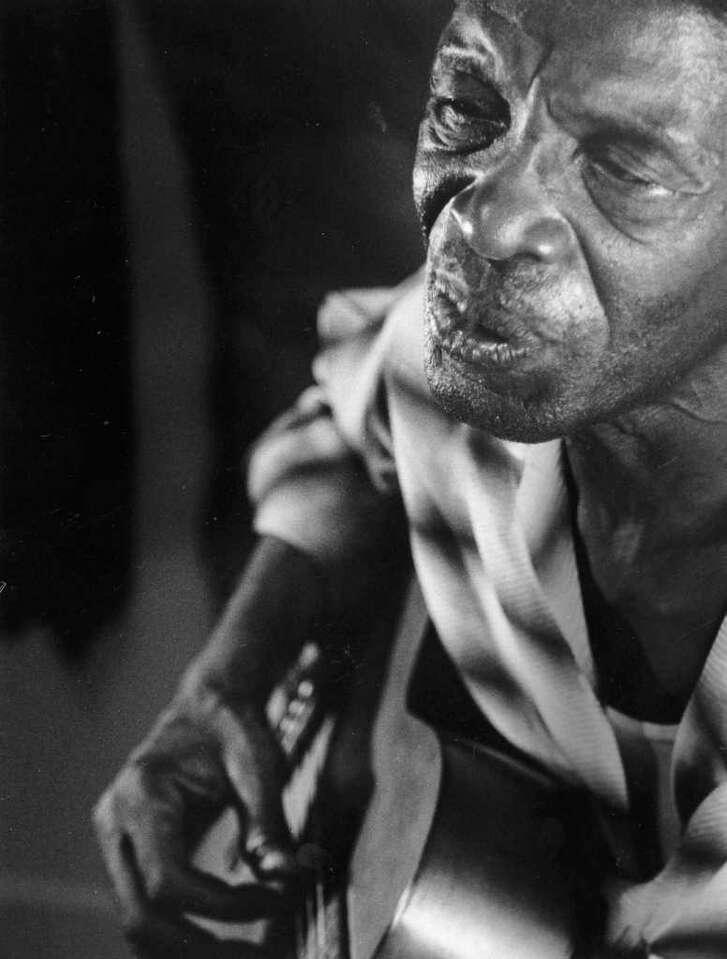 Blues artist Sam 'Lightnin' Hopkins  photo from 1963  HOUCHRON CAPTION (06/09/1963): Lightnin' moanin' low.   HOUCHRON CAPTION (07/30/1967): NO CAPTION