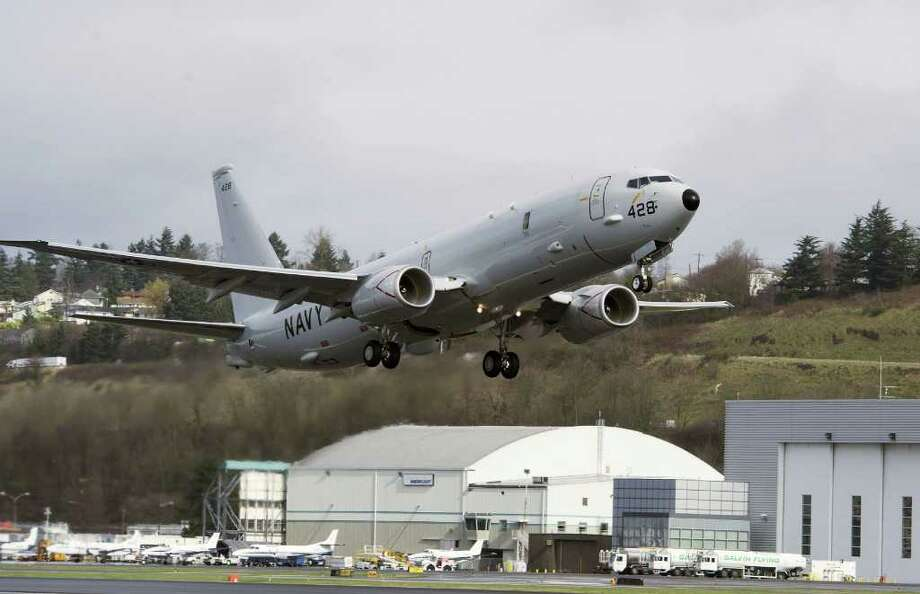 Boeing's first production P-8A Poseidon takes off from Boeing Field in Seattle on its way to Naval Air Station Jacksonville, Fla., where it will be used for aircrew training. Boeing [NYSE: BA] on March 4 officially delivered the first production P-8A Poseidon aircraft to the U.S. Navy in Seattle. Photo: Jim Anderson/Boeing Photo, 220672 / 2012 The Boeing Company