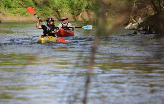 Kayakers Michael Walker (front) and his stepfather Kenny Munn guide their kayaks down to the San Antonio River to be one of the first in Bexar County to paddle on the new 12-mile Saspamco Paddling Trail in South Bexar County near Elmendorf on Mar. 3, 2012. Photo: Kin Man Hui, Kin Man Hui/Express-News / © 2012 San Antonio Express-News