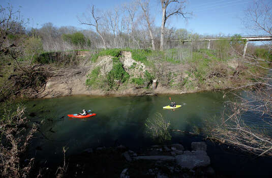 Kayaker Kenny Munn (left) and stepson Michael Walker make their way down the San Antonio River at the new 12-mile Saspamco Paddling Trail in South Bexar County near Elmendorf on Mar. 3, 2012. Photo: Kin Man Hui, Kin Man Hui/Express-News / © 2012 San Antonio Express-News