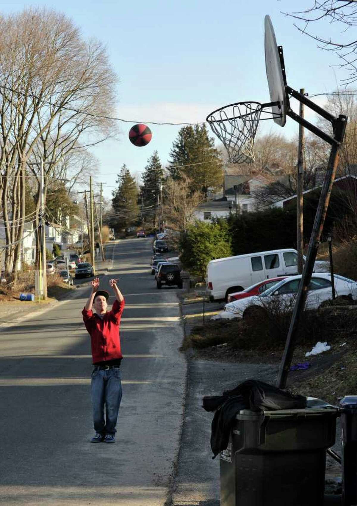 Mike Jones, of Danbury, shoots basketball with friends on Staples Street on Tuesday, March 6, 2012.