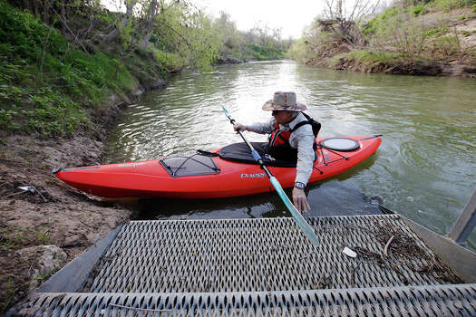 Kayaker Kenny Munn pushes off the steps of the put-in to be one of the first people to paddle along the San Antonio River at the new 12-mile Saspamco Paddling Trail in South Bexar County near Elmendorf on Mar. 3, 2012. Photo: Kin Man Hui, Kin Man Hui/Express-News / © 2012 San Antonio Express-News