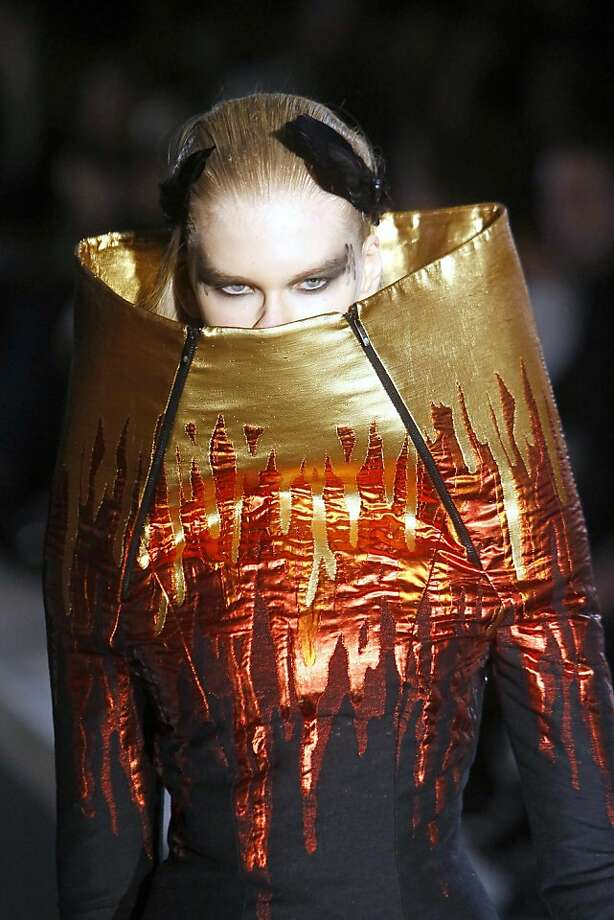 Turtlenecks are making a comeback: Angel (left) A design by Jean Charles De Castelbajac for his Fall-Winter, ready-to-wear 2013 collection makes a model's head disappear at Paris Fashion Week. Photo: Francois Mori, Associated Press