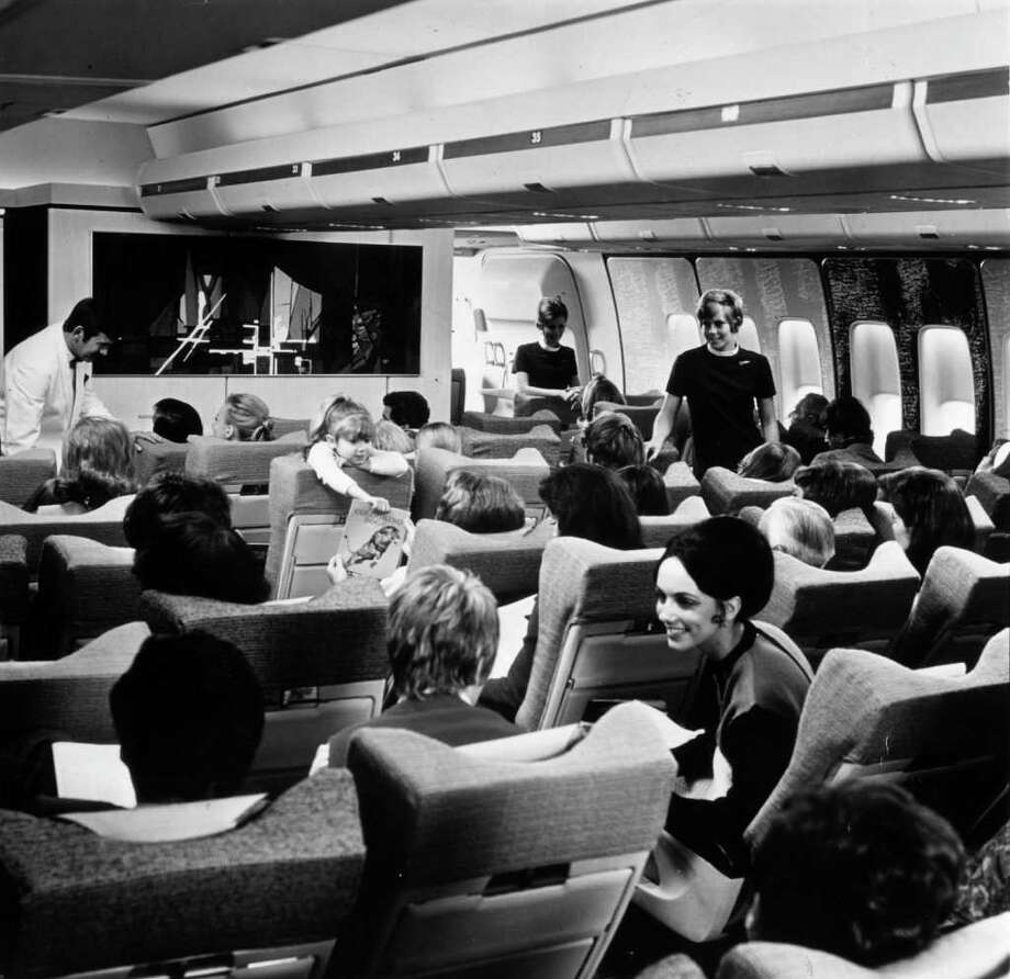 British Overseas Airways Corp. flight attendants tend to rows of passengers in a 747. BOAC got its first 747 on April 22, 1970. It merged with British European Airways to form British Airways in 1974. Photo: Fox Photos, Getty Images / Hulton Archive