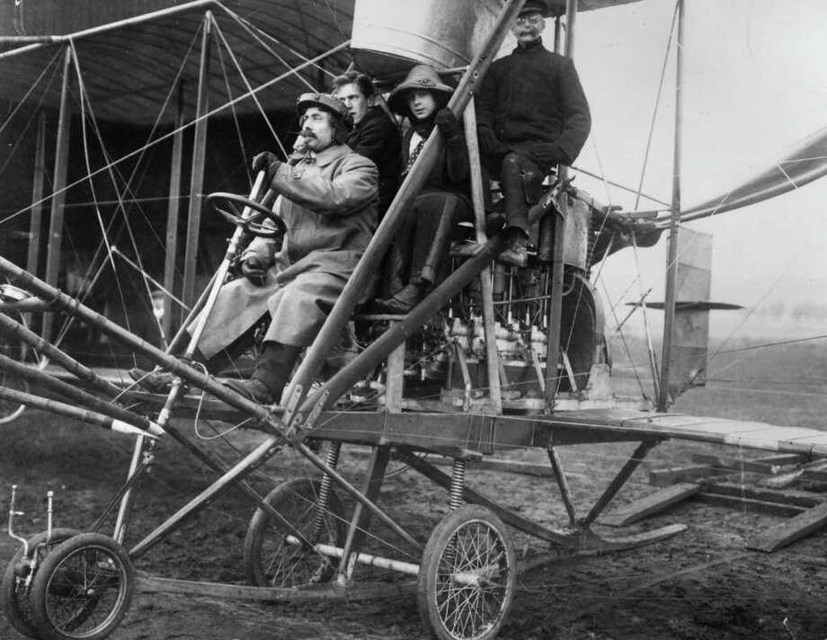Going back to the very beginning of passenger flight, of course, there were no bins. In fact, there were no walls. Here, American aviator 'Colonel' Samuel F Cody carries passengers in his biplane in 1910. Photo: Hulton Archive, Getty Images / Hulton Archive