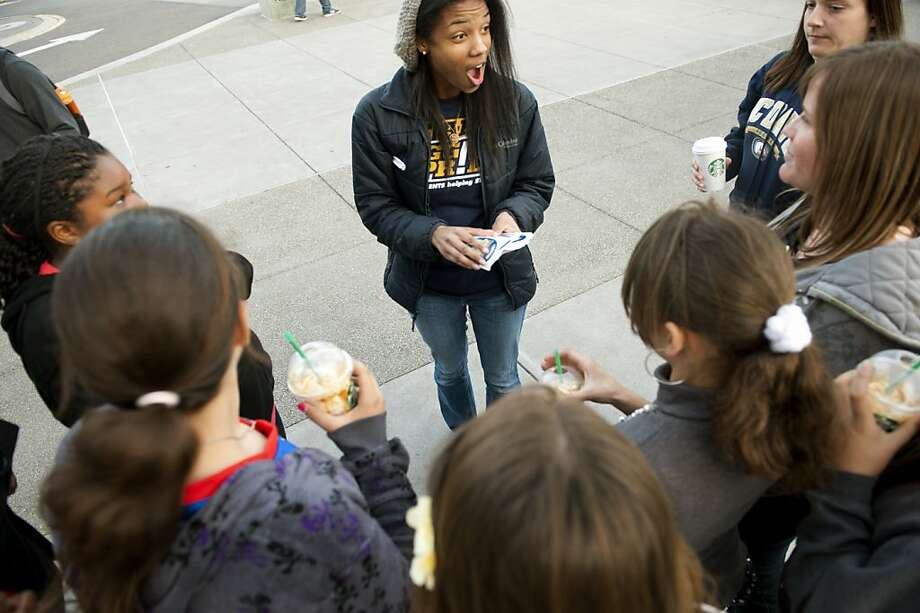 "UCD student Zena Brown talks with a group of junior high students from Sacramento and tells them about the  ""We are Aggie Pride"" Campus Celebrity Bike-a-thon fundraiser outside the Activities & Recreation Center on March 1, 2012 in Davis, CA.  Brown and six other UCD students formed a board to create a fund to support students with emergency needs.  Their goal is to raise $25,000. Photo: Anne Chadwick Williams, Special To The Chronicle"