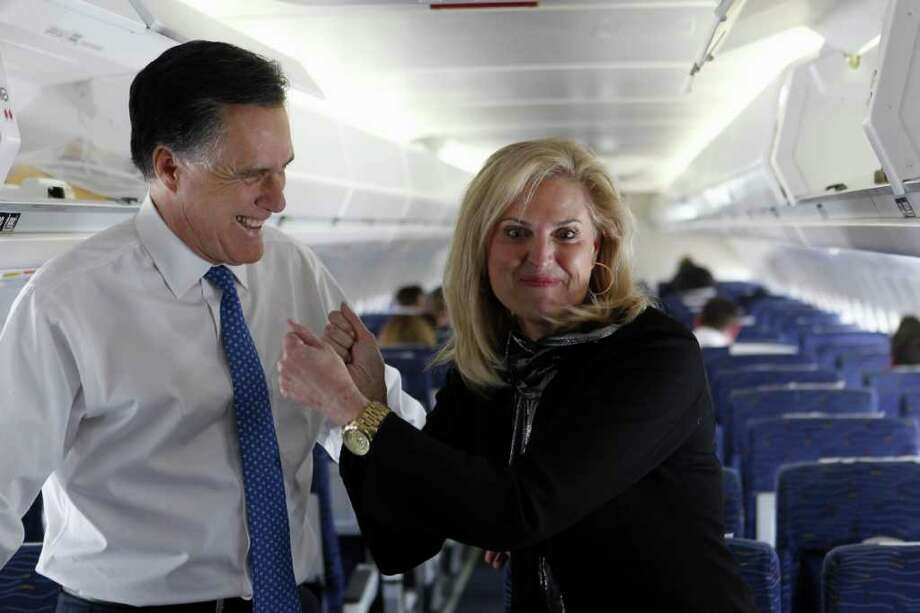 Republican presidential candidate, former Massachusetts Gov. Mitt Romney, and his wife Ann, talk to reporters on his campaign plane before taking off for Boston, in Columbus, Ohio, Tuesday, March 6, 2012. Photo: Gerald Herbert, Associated Press / AP