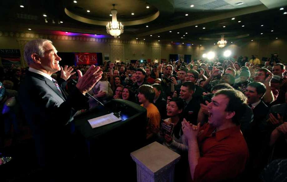 Republican presidential candidate Rep. Ron Paul, R-Texas, takes in the applause of the crowd as he address a crowd during the North Dakota caucus Tuesday, March 6, 2012, in Fargo, N.D. Photo: Charles Rex Arbogast, Associated Press / AP