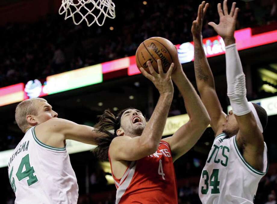 Houston Rockets power forward Luis Scola (4), of Argentina, goes to the hoop against the defense of Boston Celtics center Greg Stiemsma (54) and forward Paul Pierce (34) during the first half of an NBA basketball game in Boston Tuesday, March 6, 2012. (AP Photo/Elise Amendola) Photo: Elise Amendola, Associated Press / AP