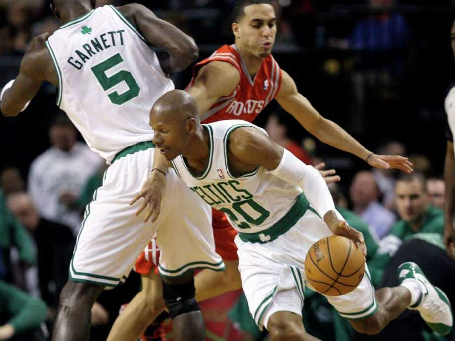 Boston Celtics guard Ray Allen (20) drives with the ball as Houston Rockets guard Kevin Martin runs into a pick by Celtics forward Kevin Garnett (5) during the first half of an NBA basketball game in Boston Tuesday, March 6, 2012. (AP Photo/Elise Amendola) Photo: Elise Amendola, Associated Press / AP