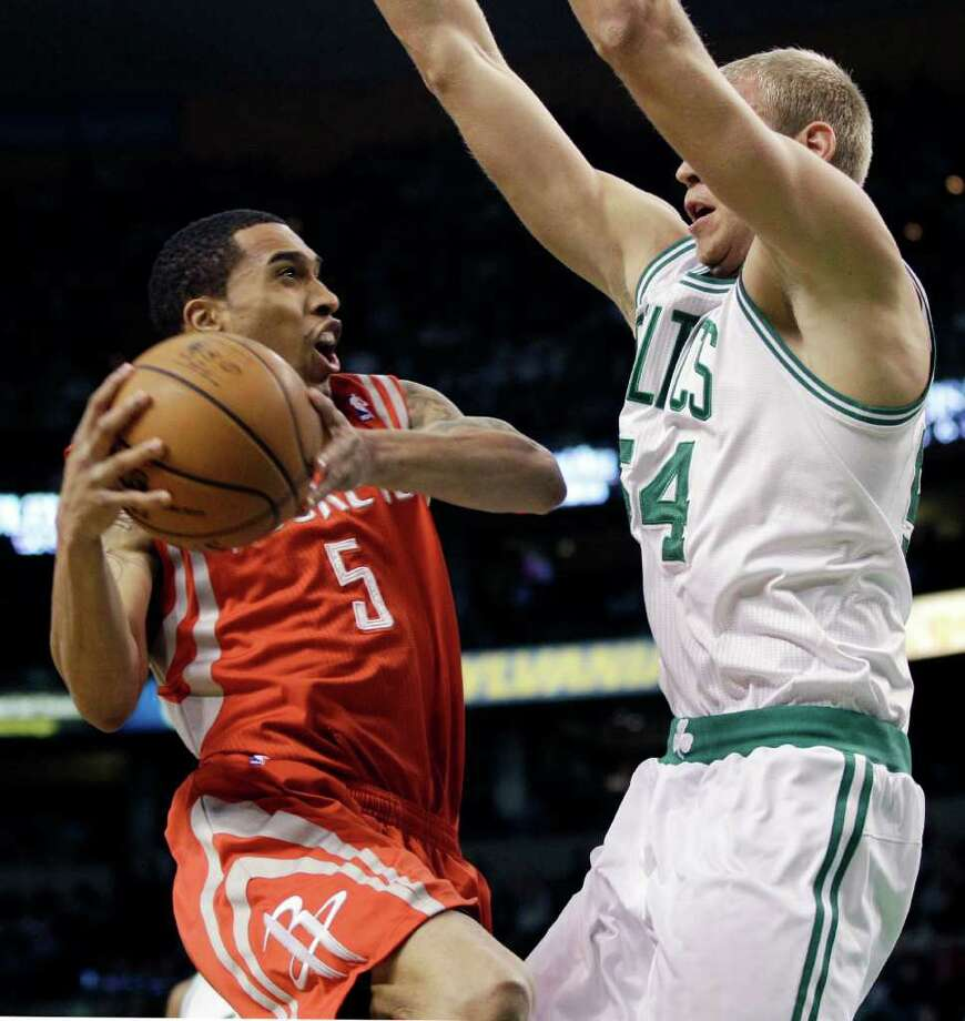 Houston Rockets guard Courtney Lee (5) makes a move against the defense of Boston Celtics center Greg Stiemsma (54) during the first half of an NBA basketball game in Boston Tuesday, March 6, 2012. (AP Photo/Elise Amendola) Photo: Elise Amendola, Associated Press / AP