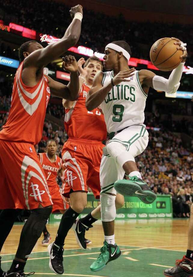 Rajon Rondo of the Boston Celtics heads for the net as Samuel Dalembert defends. Photo: Elsa, Getty Images / 2012 Getty Images