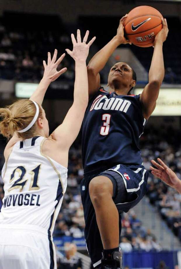 Connecticut's Tiffany Hayes, right, shoots as Notre Dame's Natalie Novosel defends during the first half of an NCAA college basketball game in the final of the Big East women's tournament in Hartford, Conn., Tuesday, March 6, 2012.Novosel fouled Hayes on the shot. (AP Photo/Jessica Hill) Photo: Jessica Hill, Associated Press / AP2012