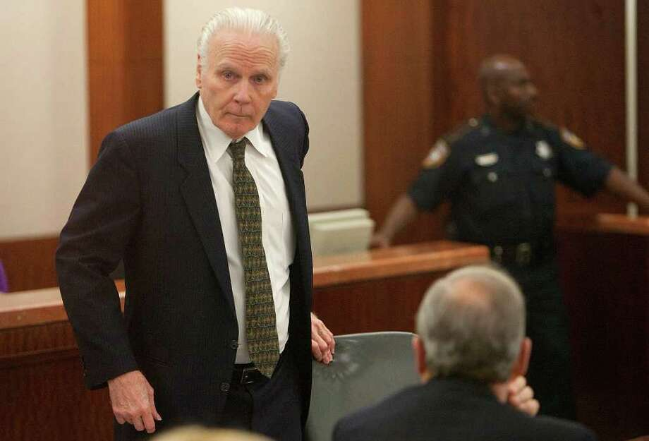 Carl Wayne Buntion looks at his attorneys before closing arguments in his sentencing retrial at the Harris county Criminal Justice Center Monday, March 5, 2012, in Houston. Buntion fatally shot a a Houston police officer more than 20 years ago. (Cody Duty / Houston Chronicle) Photo: Cody Duty / © 2011 Houston Chronicle