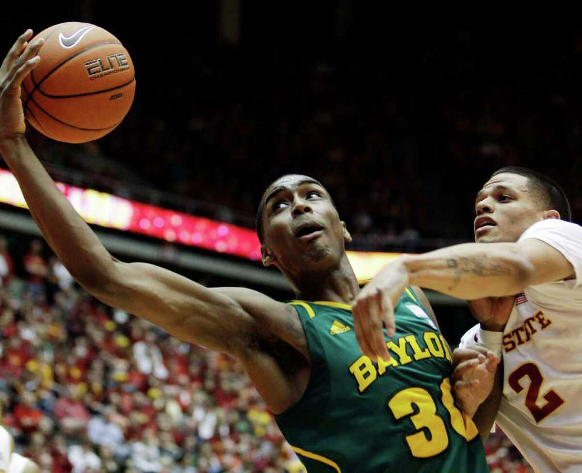 Baylor forward Quincy Miller, left, catches a pass over Iowa State guard Chris Babb, right, during the first half of an NCAA college basketball game, Saturday, March 3, 2012, in Ames, Iowa.