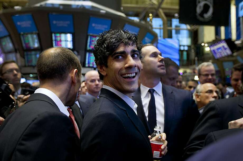 Jeremy Stoppelman, chief executive officer of Yelp Inc., center, smiles on the floor of the New York Stock Exchange (NYSE) in New York, U.S., on Friday, March 2, 2012. Yelp Inc., the site that lets users review everything from diners to dentists, surged as much as 73 percent in its first day of trading after selling shares for more than planned in an initial public offering. Photographer: Jin Lee/Bloomberg *** Local Caption *** Jeremy Stoppelman Photo: Jin Lee, Bloomberg
