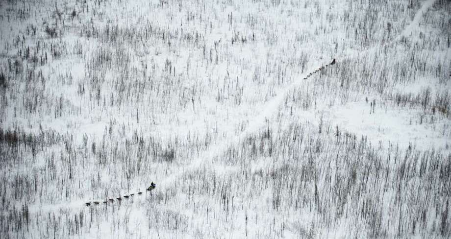 Two musher cross the Farewell Burn during the Iditarod Trail Sled Dog Race on Tuesday, March 6, 2012. Photo: Marc Lester, McClatchy-Tribune News Service / Anchorage Daily News