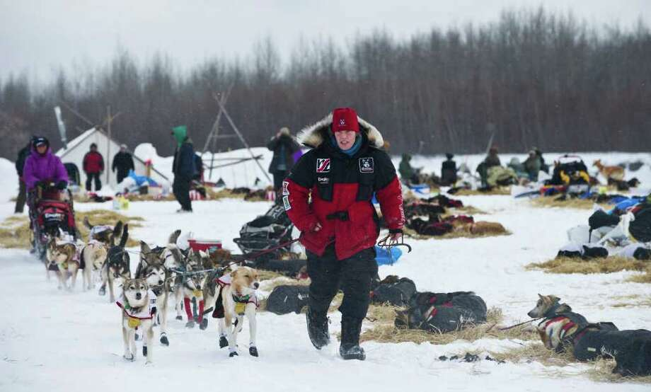 Aliy Zirkle leads her dogs from the Nikolai checkpoint in Alaska during the Iditarod Trail Sled Dog Race on Tuesday, March 6, 2012. Zirkle was the first to leave the checkpoint. Photo: Marc Lester, McClatchy-Tribune News Service / Anchorage Daily News