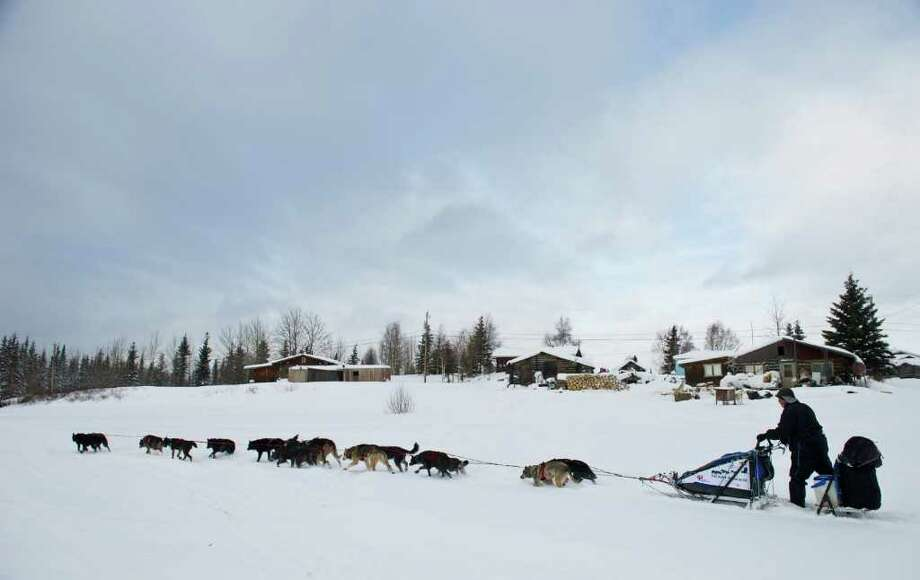 John Baker leaves the Nikolai checkpoint in Alaska during the Iditarod Trail Sled Dog Race on Tuesday, March 6, 2012. Photo: Marc Lester, McClatchy-Tribune News Service / Anchorage Daily News